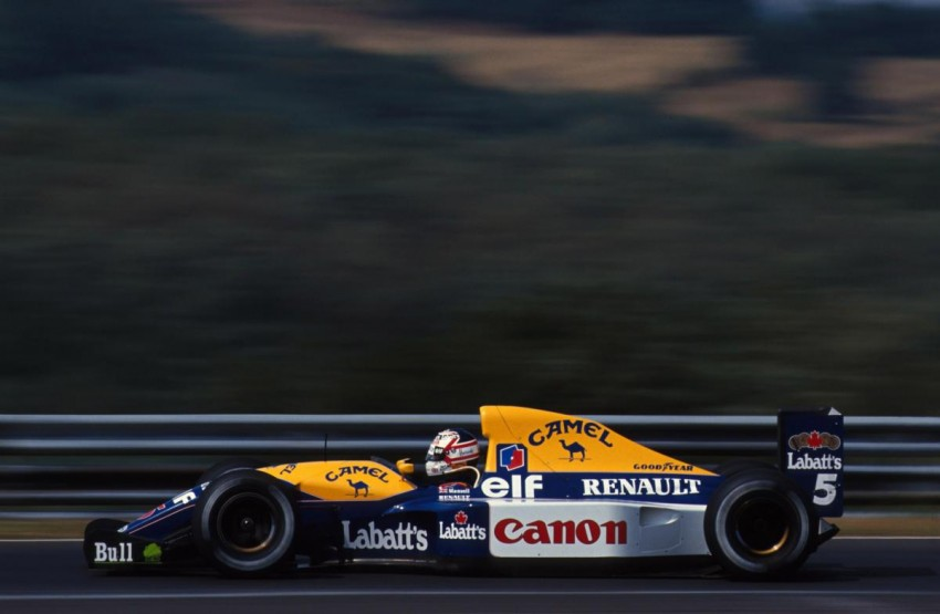 Williams FW14B. Ne zna se dal je brži ili ljepši ? S Nigelovom kacigom oboje. Aktivni ovjes, kontrola trakcije..i rijetko viđena ljepota. Nige je dobio ''samo'' devet utrka u njemu u 1991. i odnio naslov bez konkurencije.